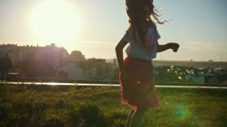 Little child girl is running, playing and laughing, slow-motion