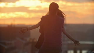 Loving Couple Romancing at sunset in slow motion