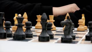 Male hands on the game of chess