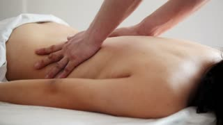 Massage of the female back in the physiotherapy room