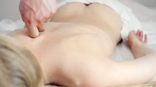 Medical massage. Hands of the masseur doing treatment - close-up