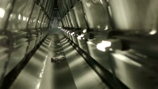 Medications move inside conveyor belt in the warehouse of the pharmacy