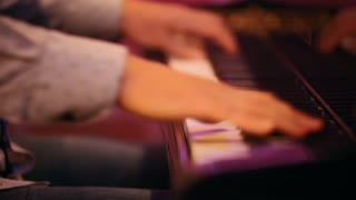 Men's hands play the keys, a performance in a jazz bar