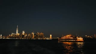 New York City Manhattan Skyline at night from Staten island ferry