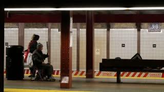 NEW YORK, USA - DECEMBER 2017: Chinese man street musician playing Erhu music in the NYC metro