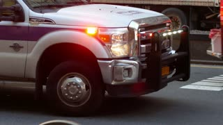 NEW YORK, USA - DECEMBER, 2017: FDNY ambulance - track in Manhattan - emergency lights
