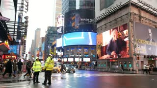 NEW YORK, USA - DECEMBER, 2017: Street view of Manhattan skyscrapers, windows, digital screens, advertising and police officers