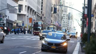 NEW YORK, USA - DECEMBER , 2017: taxi cabs driving on 5-th avenue in New York