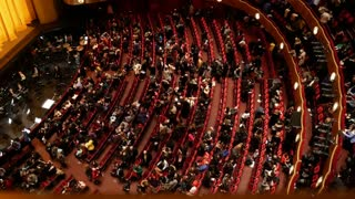 NEW YORK, USA- DECEMBER 2017: top view of the spectators of the theater leaving the auditorium after the performance