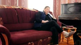 Old Woman pensioner speak landline phone, portrait