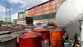 On the territory of a closed plant there are tanks with spent oil products