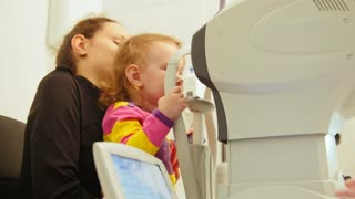 Ophthalmology clinic - Mother and child Checks girl's Eye