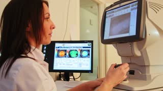 Ophthalmology diagnostic - eyes clinic working with patient by modern computer technology