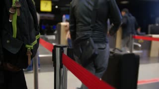 Passengers standing in queue for check-in at airport
