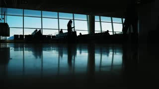 Passengers walking inside the air terminal Airport - silhouette