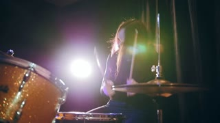 Passionate girl playing the drums - rock performing, slow motion