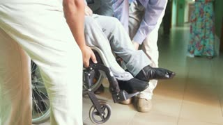 People bears the disabled man on wheelchair - inaccessible environment