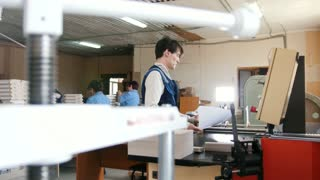 Printing process - feeding sheets of paper, polygraph industry, close up