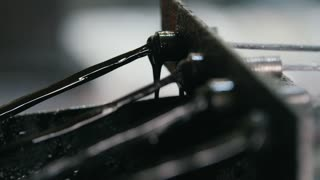 Producing of fiberglass reinforcement - the wire passes through the engine oil