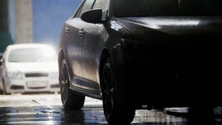 Professional car washing in auto service, silhouette