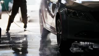 Professional car washing in auto service