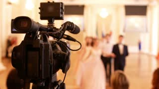 Professional videography shoots people in vintage ball costumes at the historical ball
