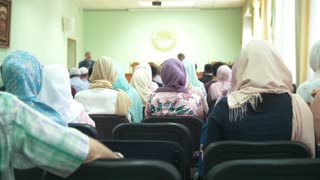 Rear view of muslim women in hijab at the islamic mass rally