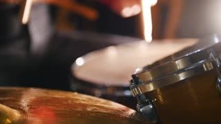 Repetition. Girl actively playing drums. Water on a hi-hat