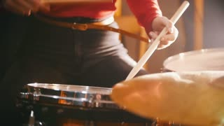 Repetition. Girl actively playing on wet drums. Snare. Water splash. Slow motion