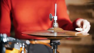 Repetition. Girl playing drums. Hi-hat close up