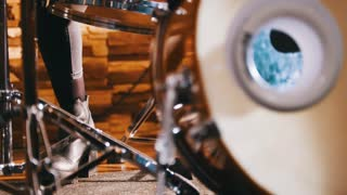 Repetition. Girl playing drums. Kick. Only legs shown