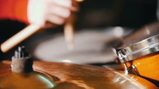 Repetition. Girl playing drums. Only hands shown. Slow motion