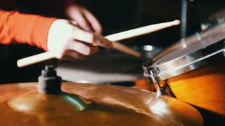 Repetition. Girl playing drums. Only hands shown