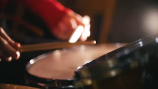 Repetition. Girl playing drums. Snare close up. Slow motion