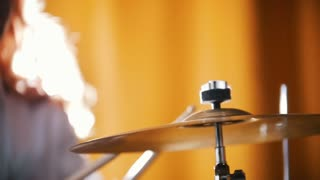 Repetition. Girl plays drums. Raid vibration. Backlights.