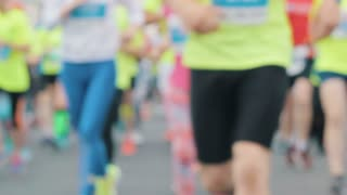 Runners athletes run on the marathon, blurred