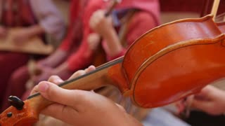 Russian folk group musician - woman play violin