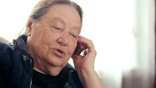 Senior lady - old Woman speak telephone, portrait