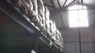 Shelves of cardboard boxes inside a storage food warehouse