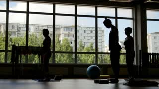 Silhouette of women in the gym - yoga training