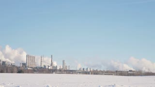 Skyline of the industrial city and a large energy and chemical plant with pipes and tanks