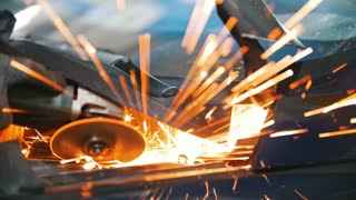 Sparks from welding car parts in a car repair shop