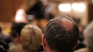 Spectators are watching theatrical performance - bald man
