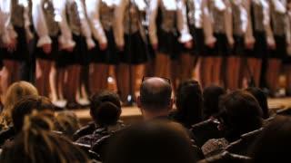Spectators in concert hall - bald man watching choir of children singers