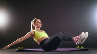 Sportive blonde woman doing intense fitness training at gym. Female athlete in sportswear