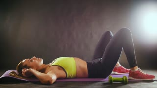 Sportive woman doing intense fitness training at gym. Female athlete in sportswear, slow-motion