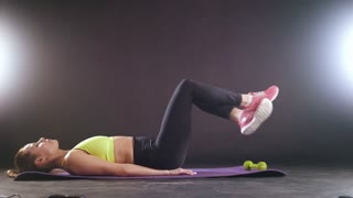 Sportive woman doing intense fitness training at gym. Female athlete in sportswear