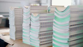 Stacks of folded printed editions on the table