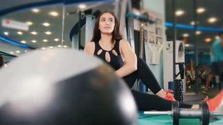 Straching in the gym - young women exercising healthy lifestyle in fitness studio - slider shot