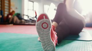 Straching in the gym - young women exercising healthy lifestyle in fitness studio